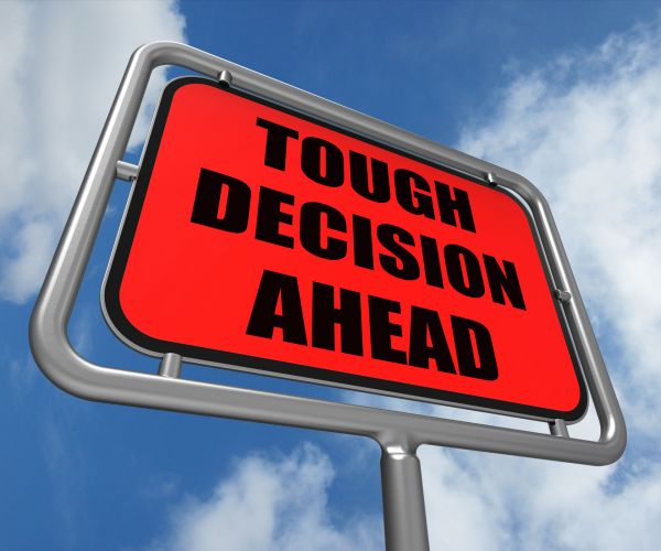 photos/1544109002_stockvault-tough-decision-ahead-sign-means-uncertainty-and-difficult-choice231826-002-.jpg
